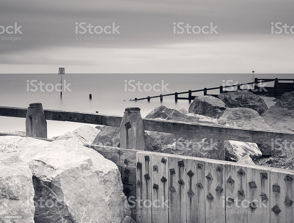 Rock armour and wooden groynes at Aldeburgh, Suffolk, UK stock photo