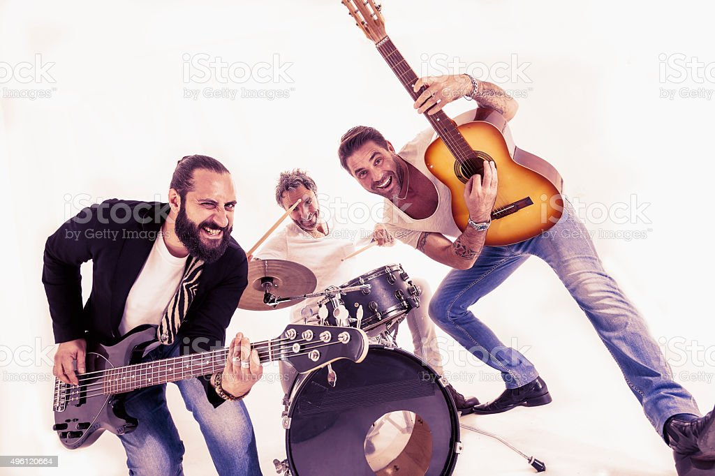 rock band performing in a studio stock photo