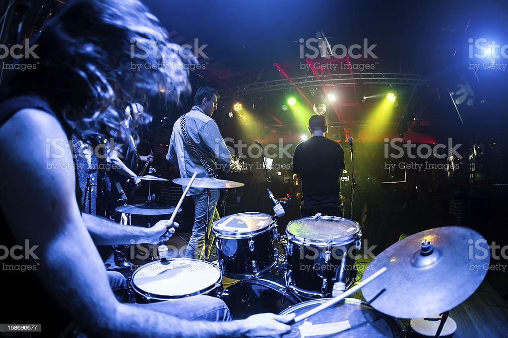 Rock band playing a show with lights stock photo