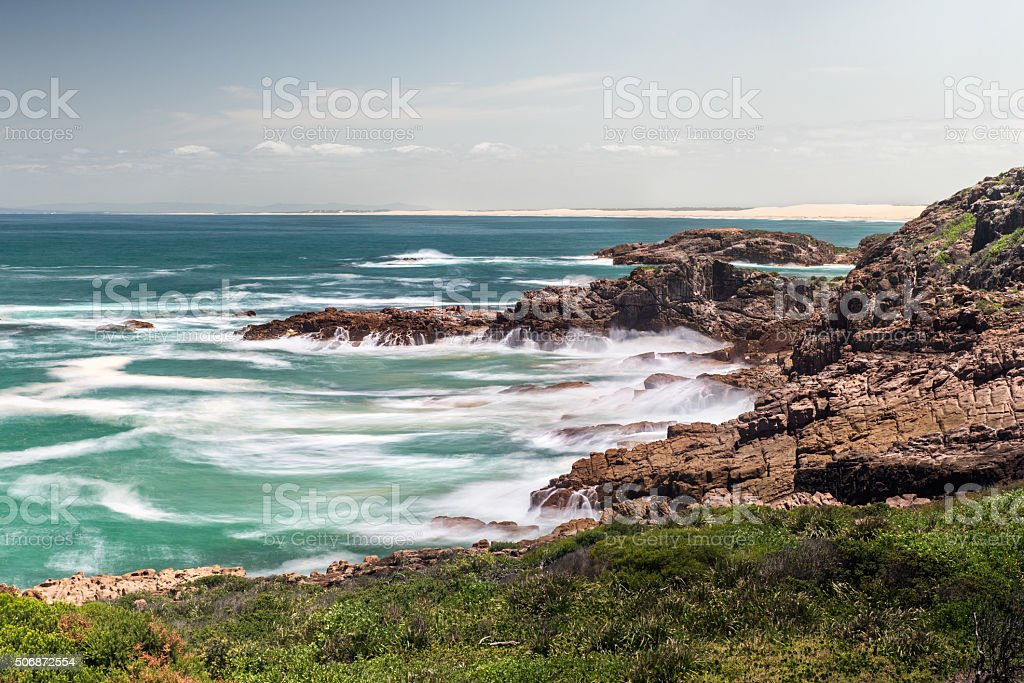 Rock Beach with surf stock photo