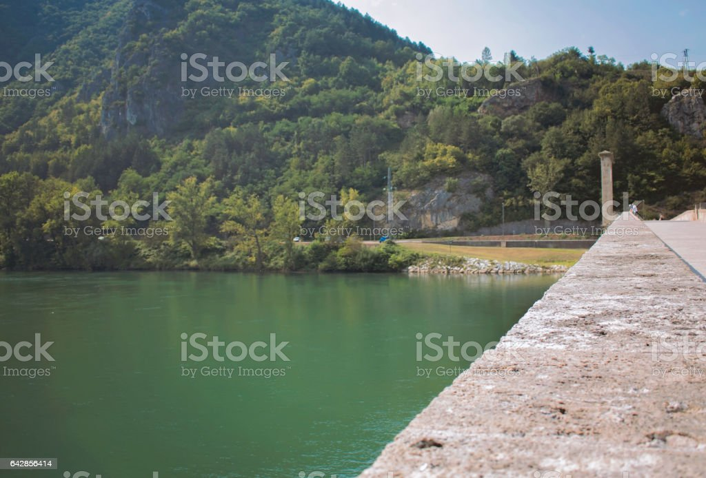 Rock bridge over forest channel stock photo