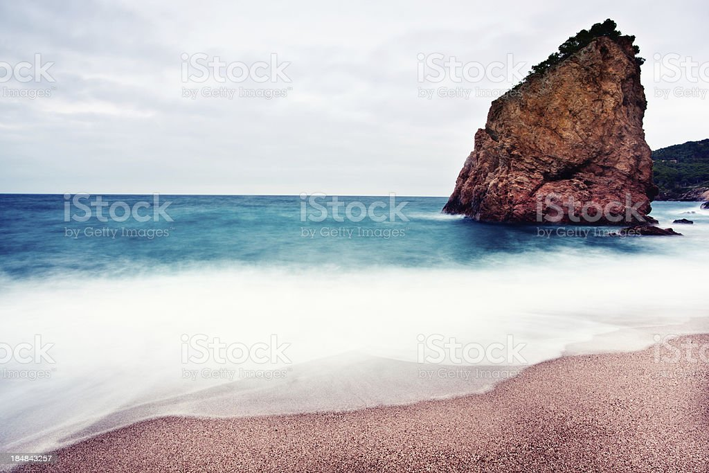 Rock by seaside in long exposure. stock photo