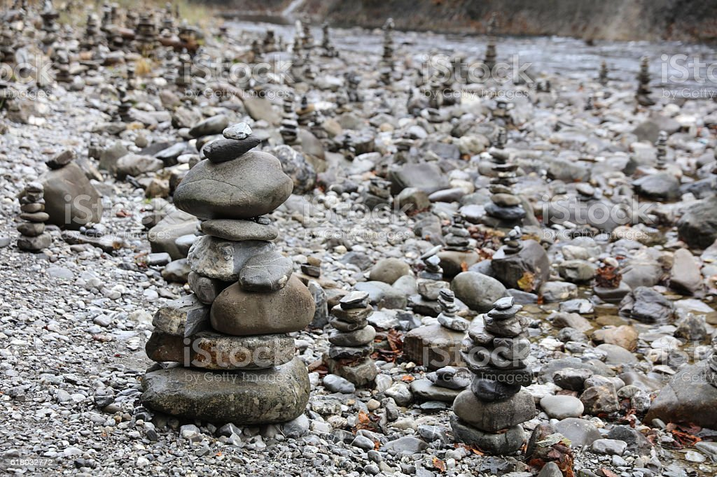 Rock Cairns in Breitach Creek. Allgau. Germany stock photo