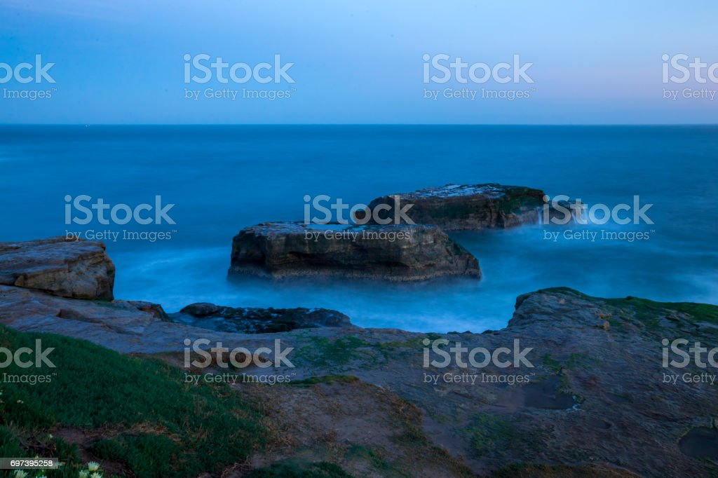 Rock cliff in Santa Cruz stock photo