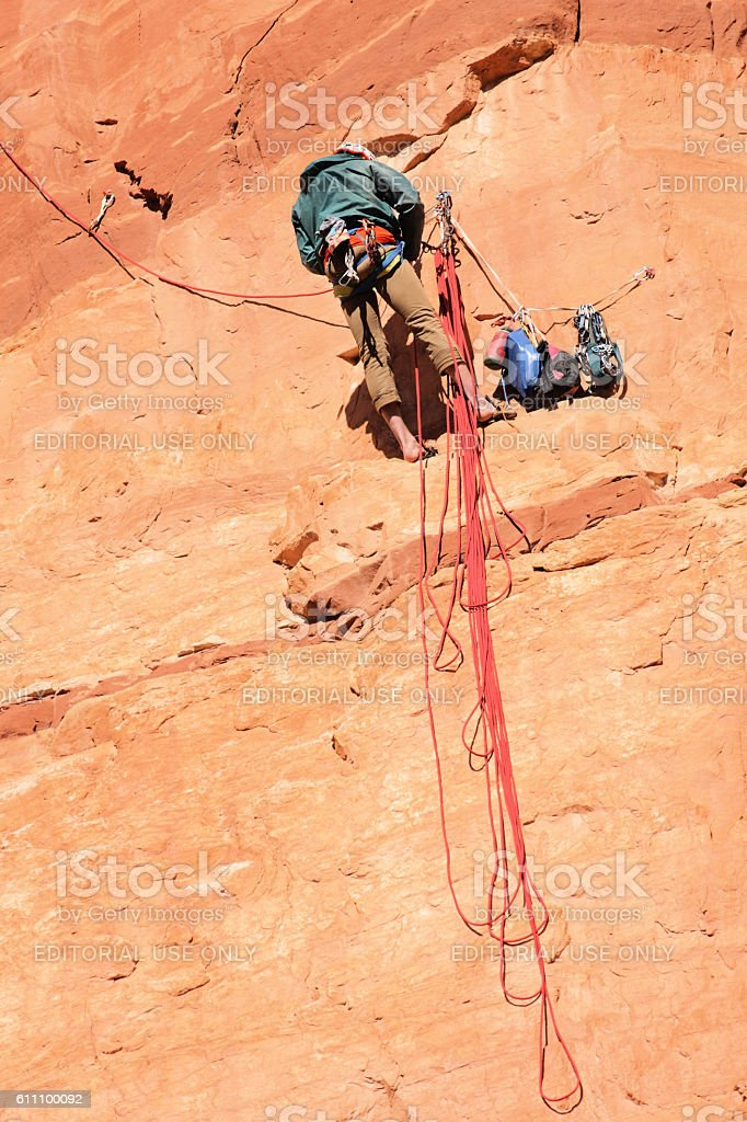 Rock Climber Ascends Cliff Face Bolted Route stock photo