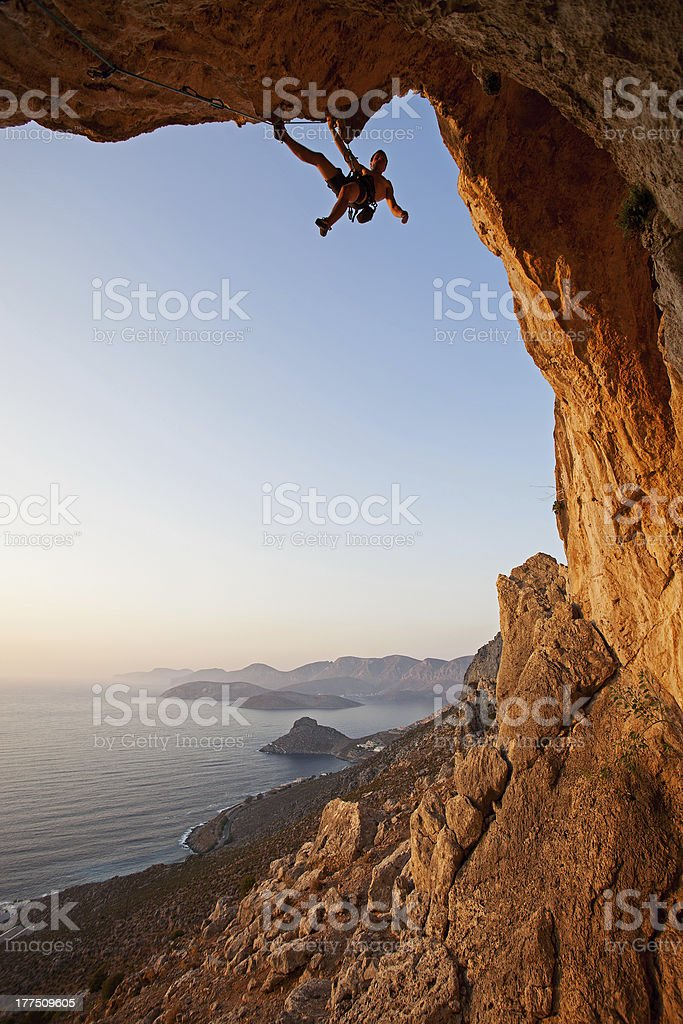 Rock climber at sunset stock photo
