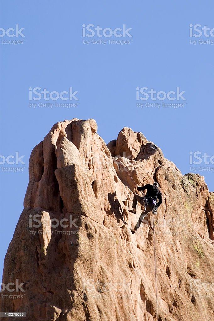 Rock Climber at the Top royalty-free stock photo