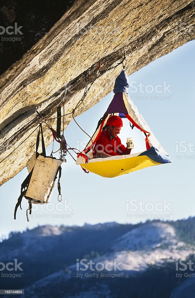 Rock climber bivouaced in a portaledge. royalty-free stock photo