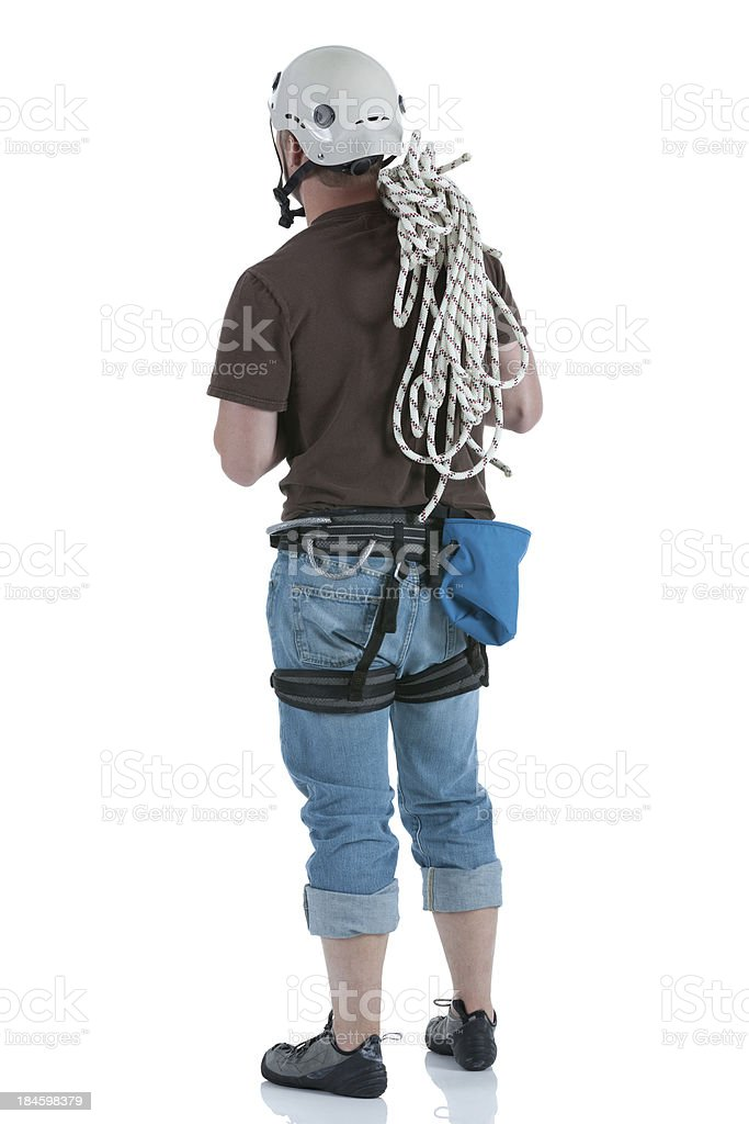 Rock climber carrying rope on his shoulders royalty-free stock photo