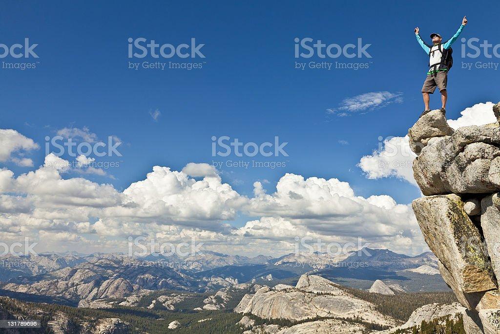 Rock climber celebrates on the summit. royalty-free stock photo