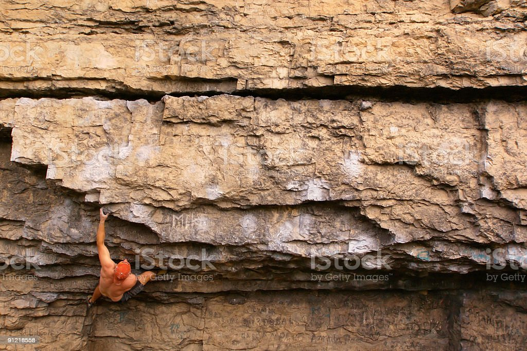 rock climber climbing on limestone wall stock photo