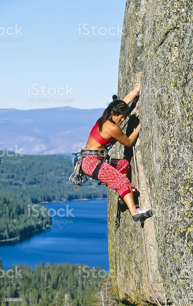 Rock climber clinging to a cliff. royalty-free stock photo