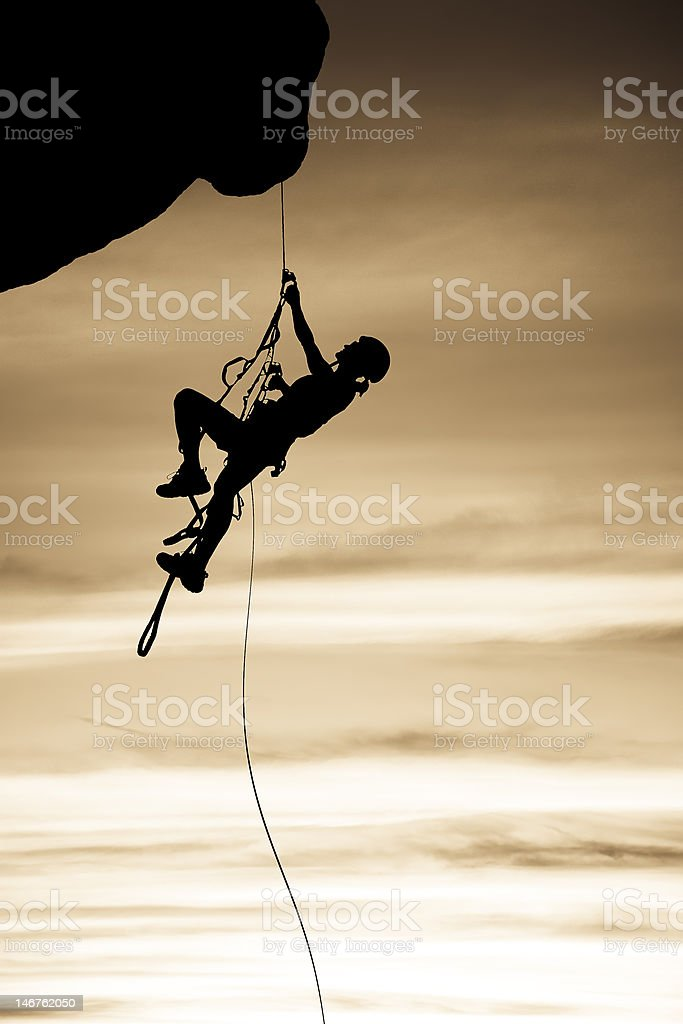 Rock climber dangling from a rope. royalty-free stock photo