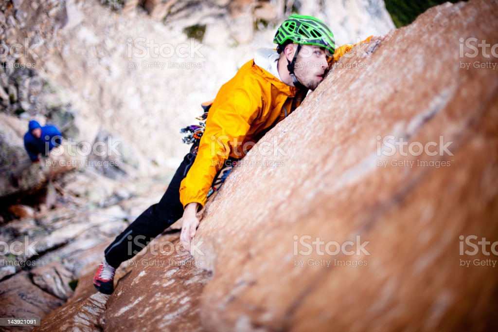 Rock climber looking up the route royalty-free stock photo