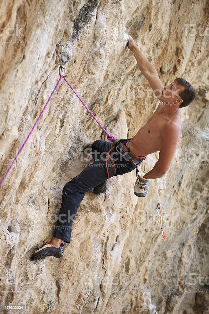 Rock climber on face of a cliff royalty-free stock photo