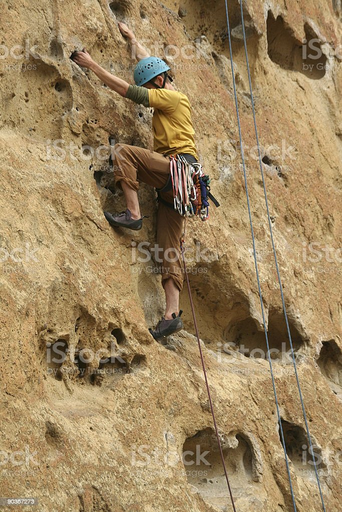 Rock climber on potholes route stock photo
