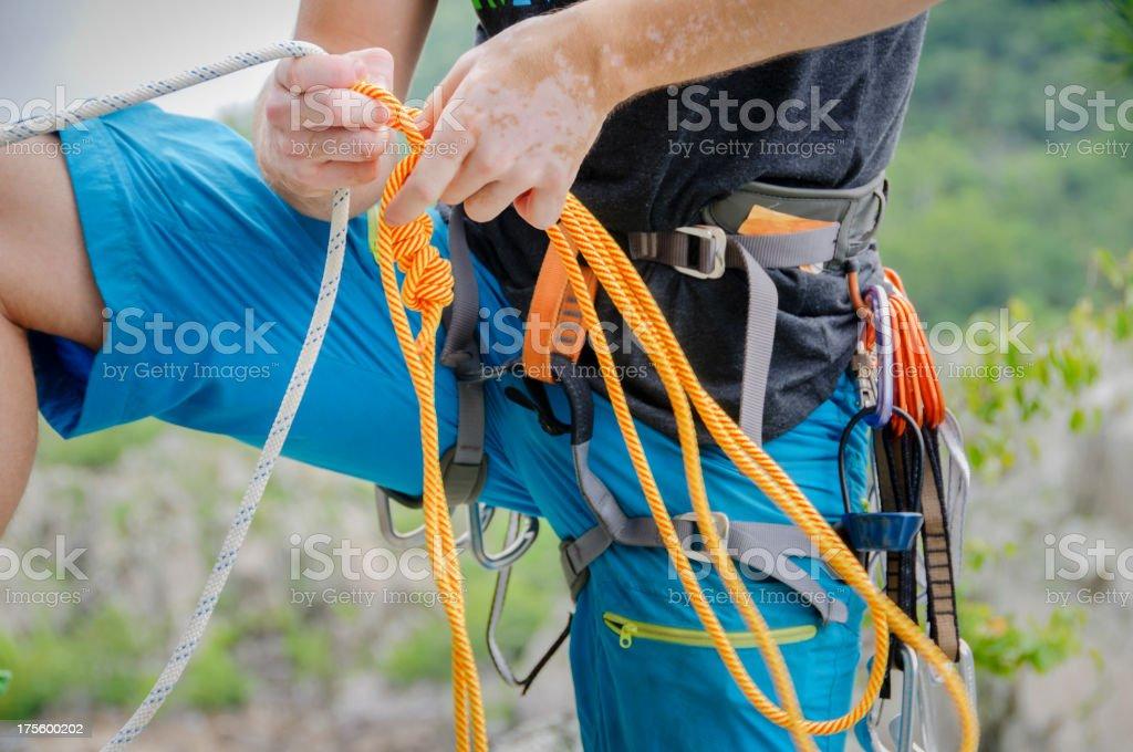 Rock climber preparing a rope stock photo