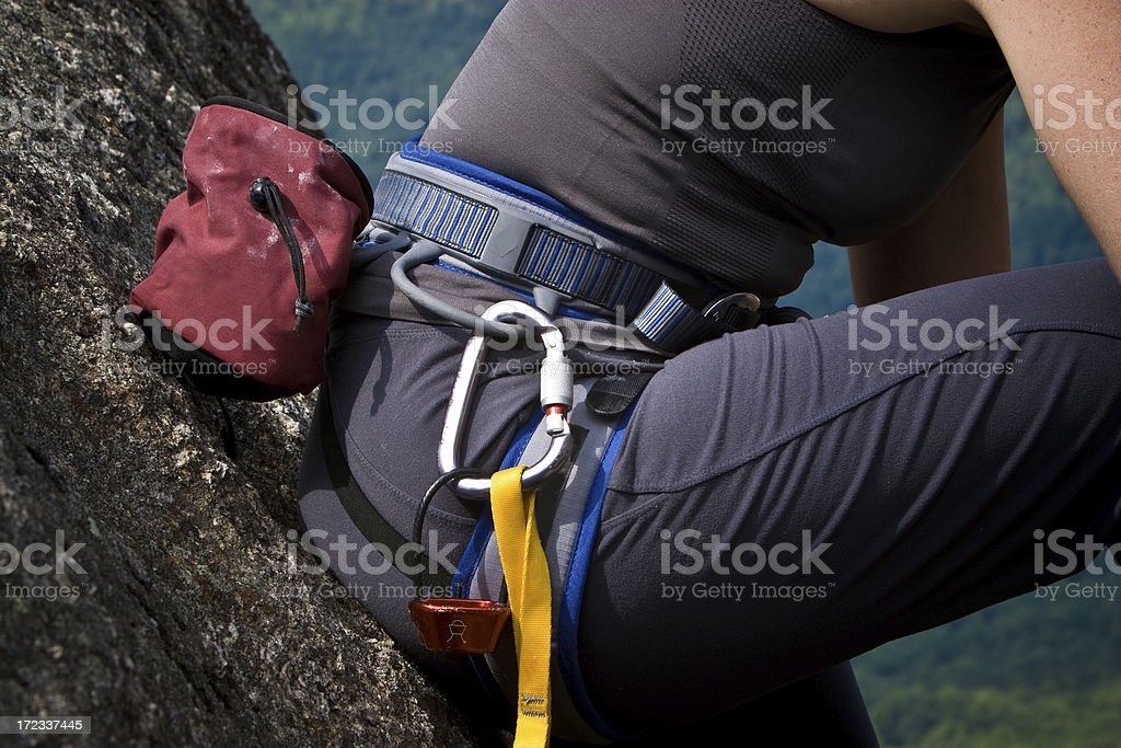 Rock climber preparing for a climb royalty-free stock photo