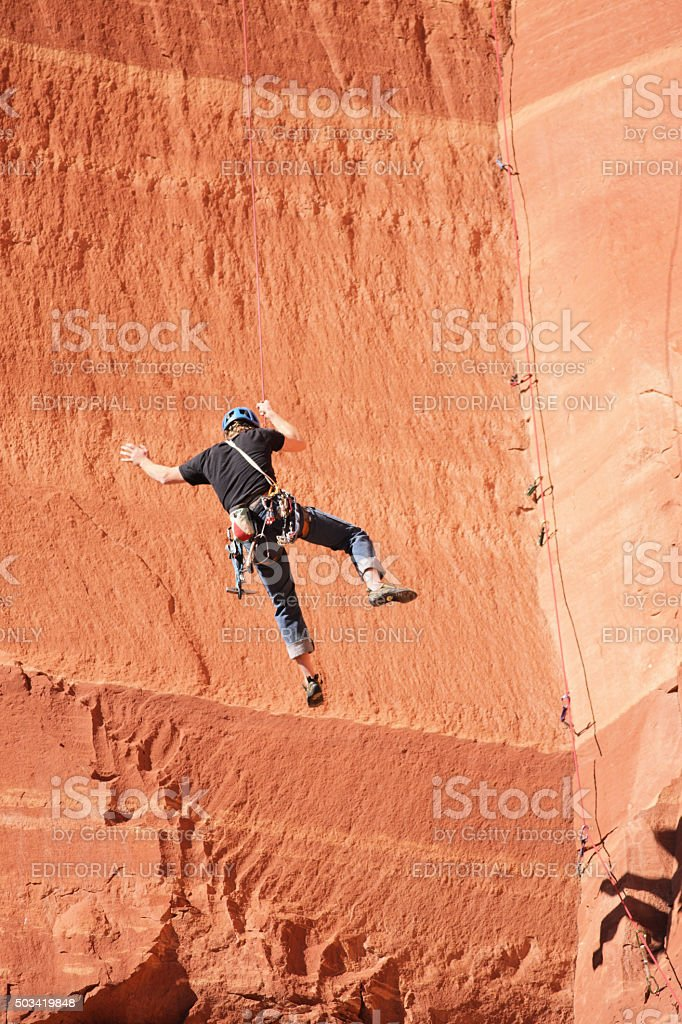 Rock Climber Rappelling Belaying stock photo