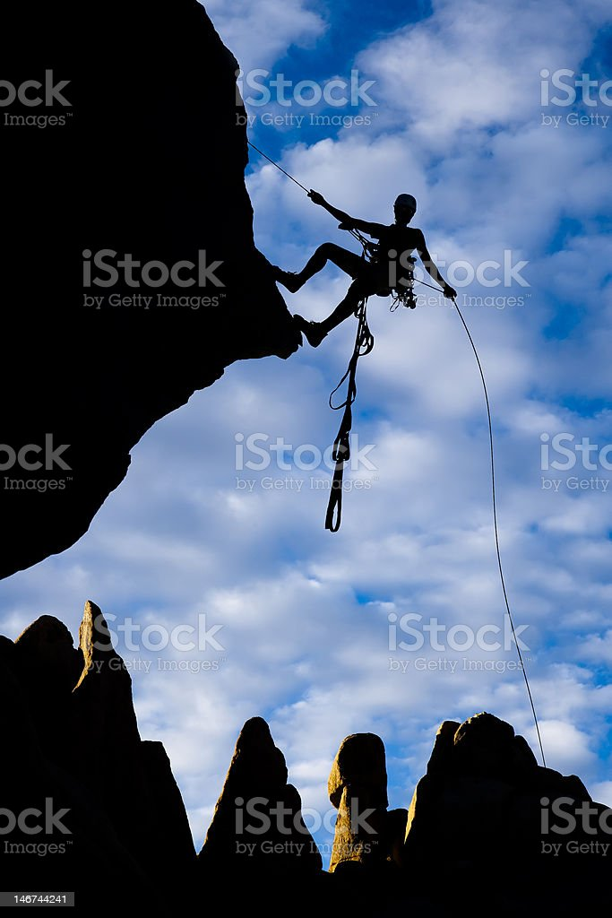Rock climber rappelling. royalty-free stock photo