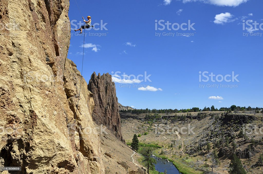 Rock Climber Rappelling stock photo
