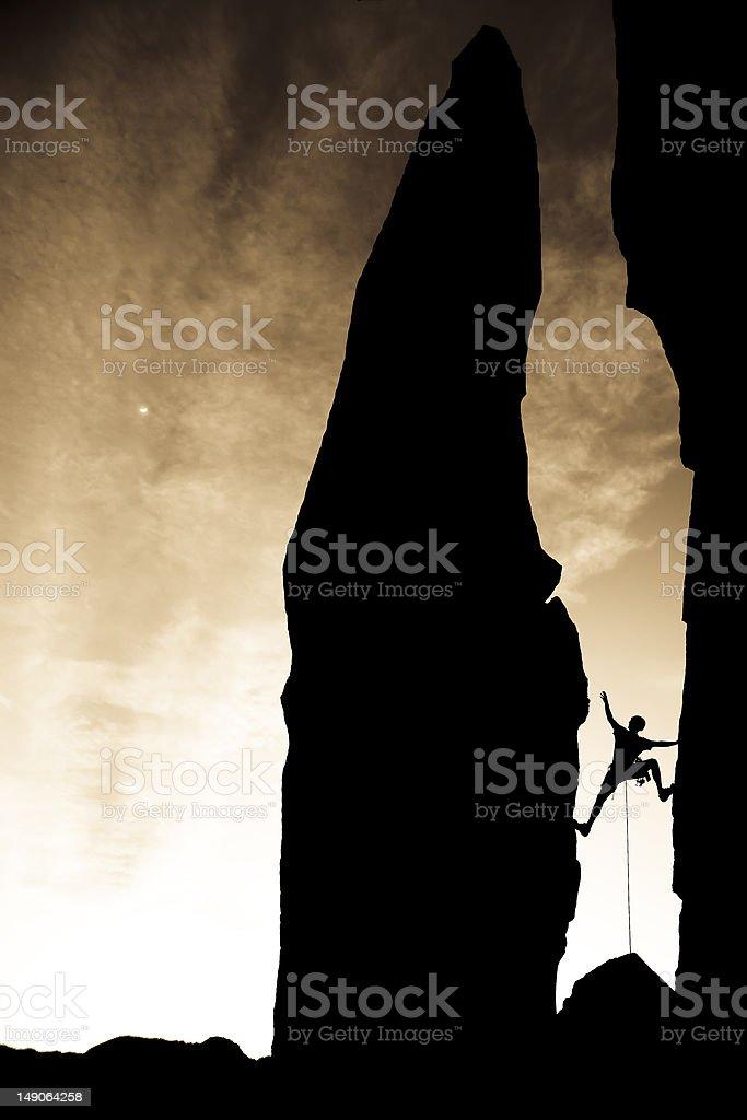 Rock climber reaching across a gap. royalty-free stock photo