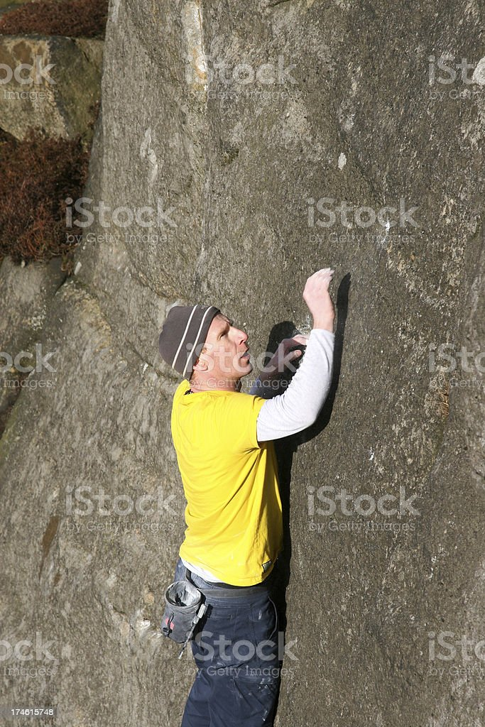 Rock Climber reaching up for a handhold, Stanage Edge, Peak stock photo