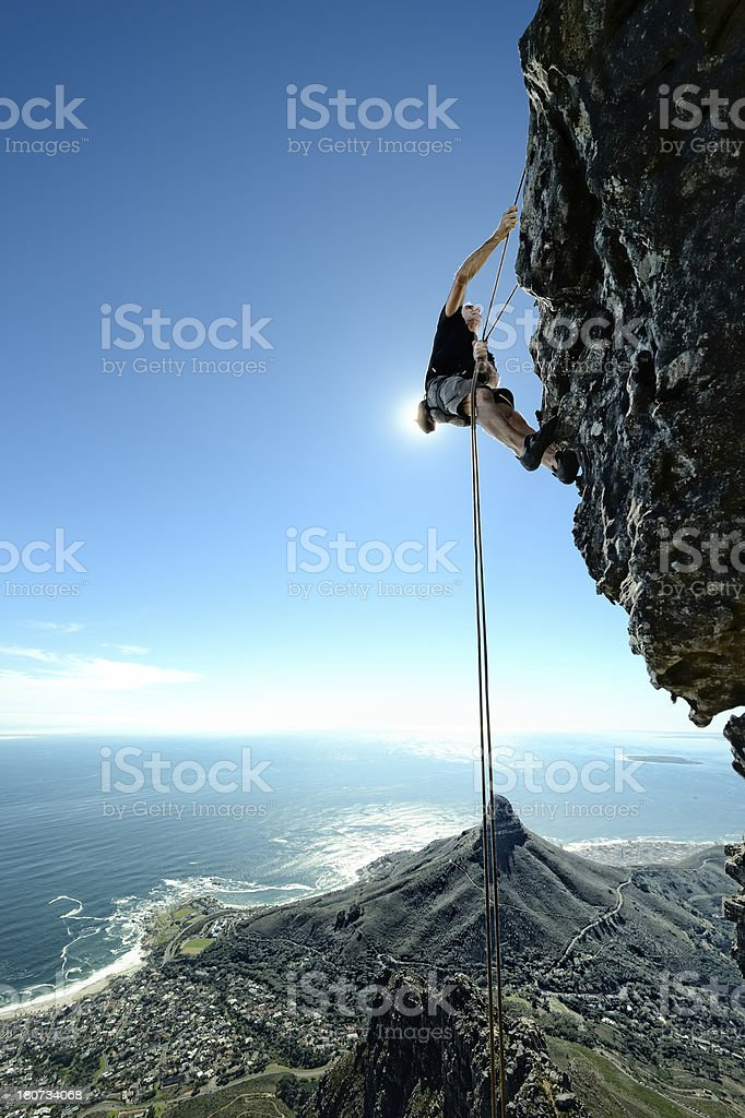 Rock climber scaling steep face royalty-free stock photo