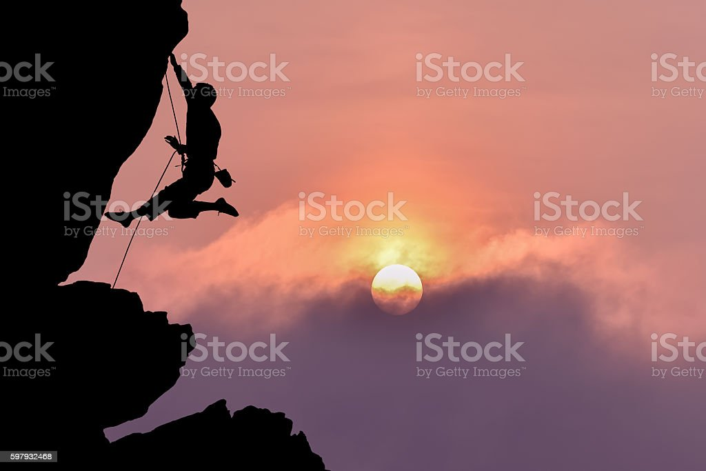 Rock climber silhouette over beautiful night sky stock photo