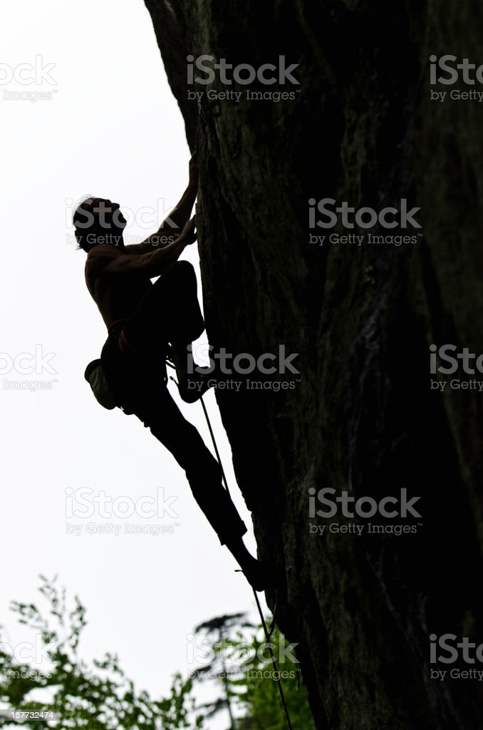 Rock Climber Silhouette going up