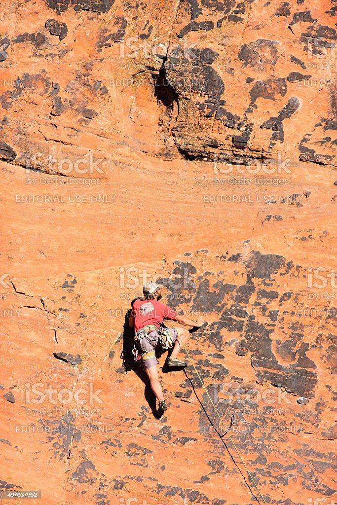 Rock Climber Solo Climbing Mountain stock photo