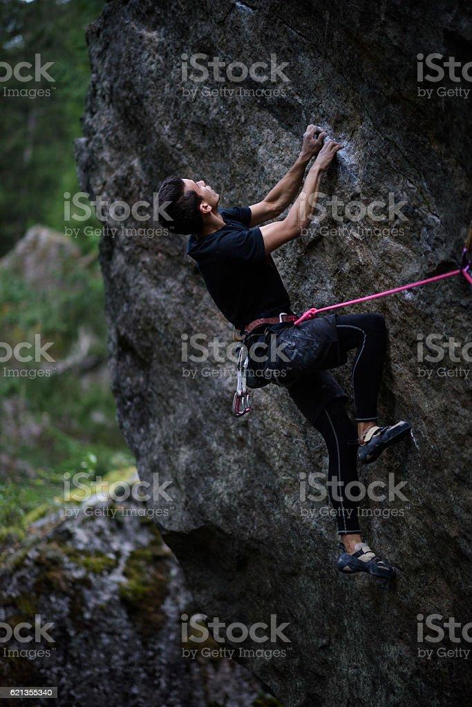Rock climber struggle for success. Extreme sport climbing. stock photo