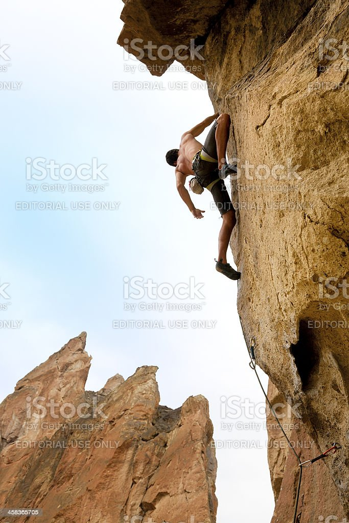 Rock Climber up on the way stock photo