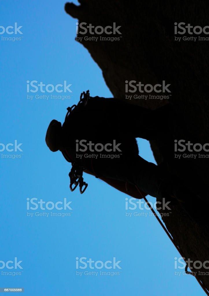 Rock climber with climbing equipment. stock photo