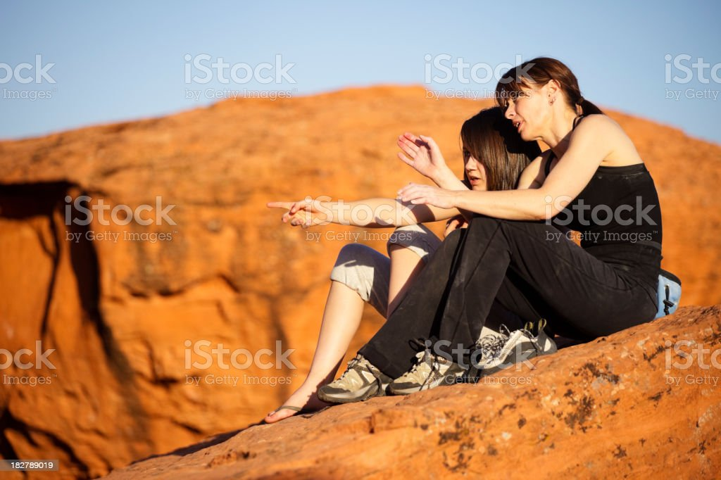 Rock Climbers Analyzing the Route royalty-free stock photo