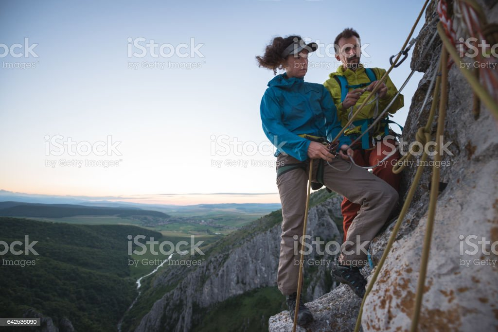 Rock climbers preparing to contine their acension stock photo