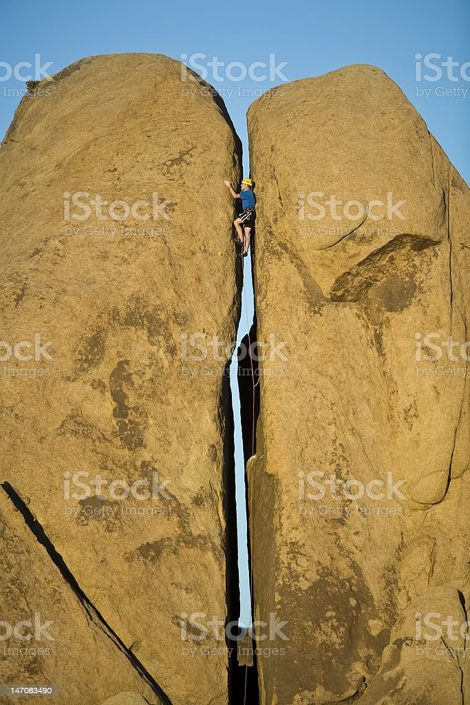 Rock climbing a split pillar. royalty-free stock photo