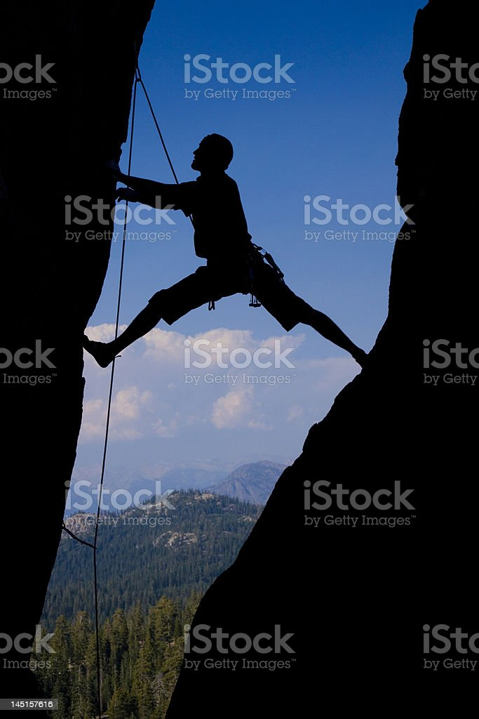 Rock climbing an chimney royalty-free stock photo
