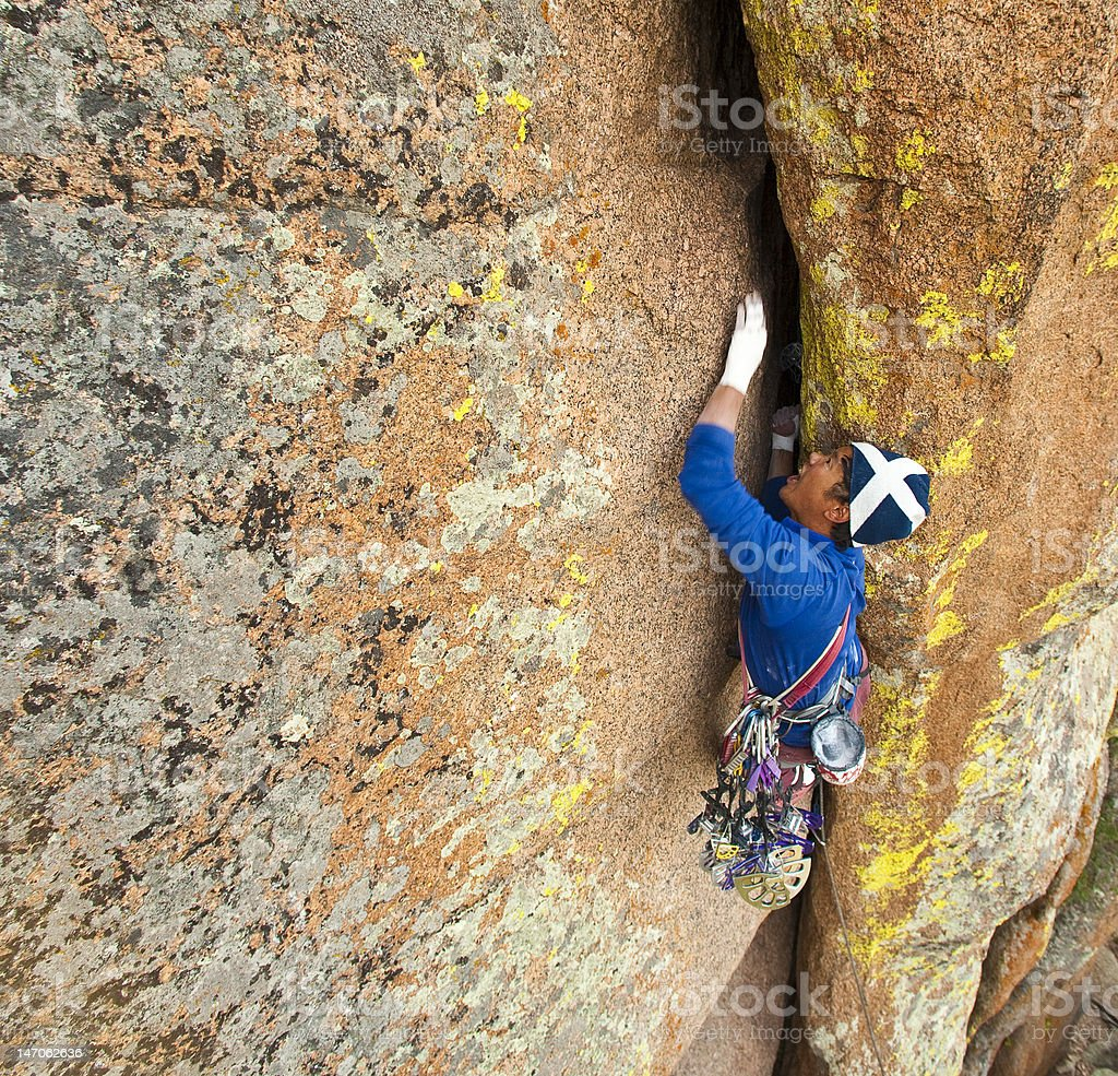 Rock climbing an offwitdth crack royalty-free stock photo