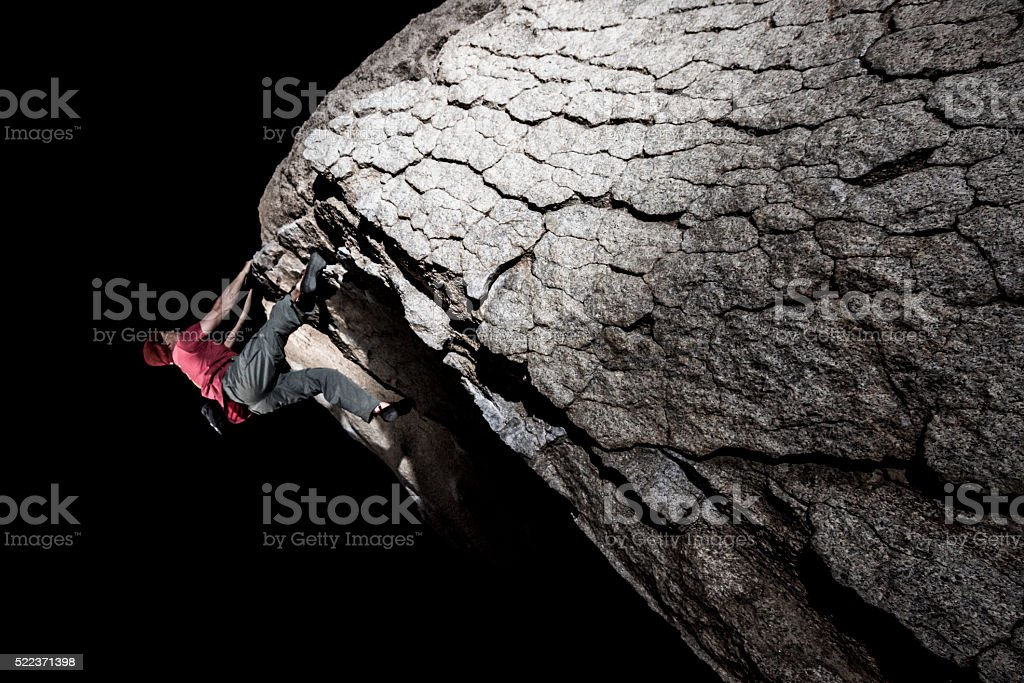 rock climbing at night stock photo