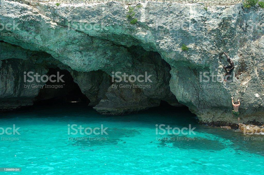 Rock climbing in Jamaica royalty-free stock photo