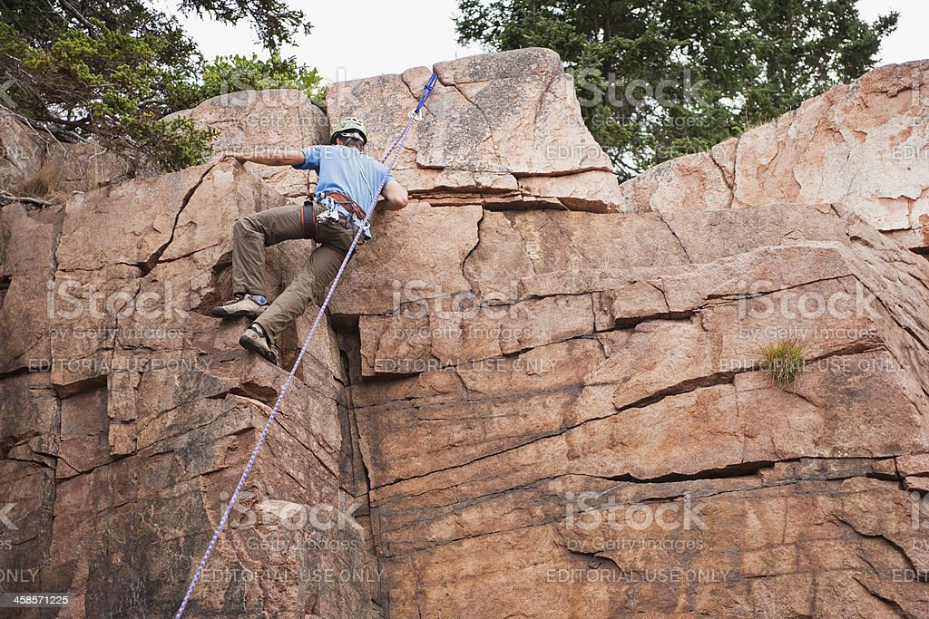 Rock climbing Otter Cliffs in Acadia National Park stock photo