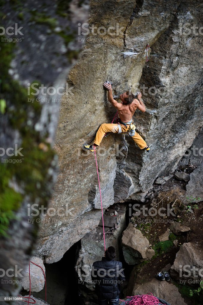 Rock climbing team on a challenging ascent. stock photo
