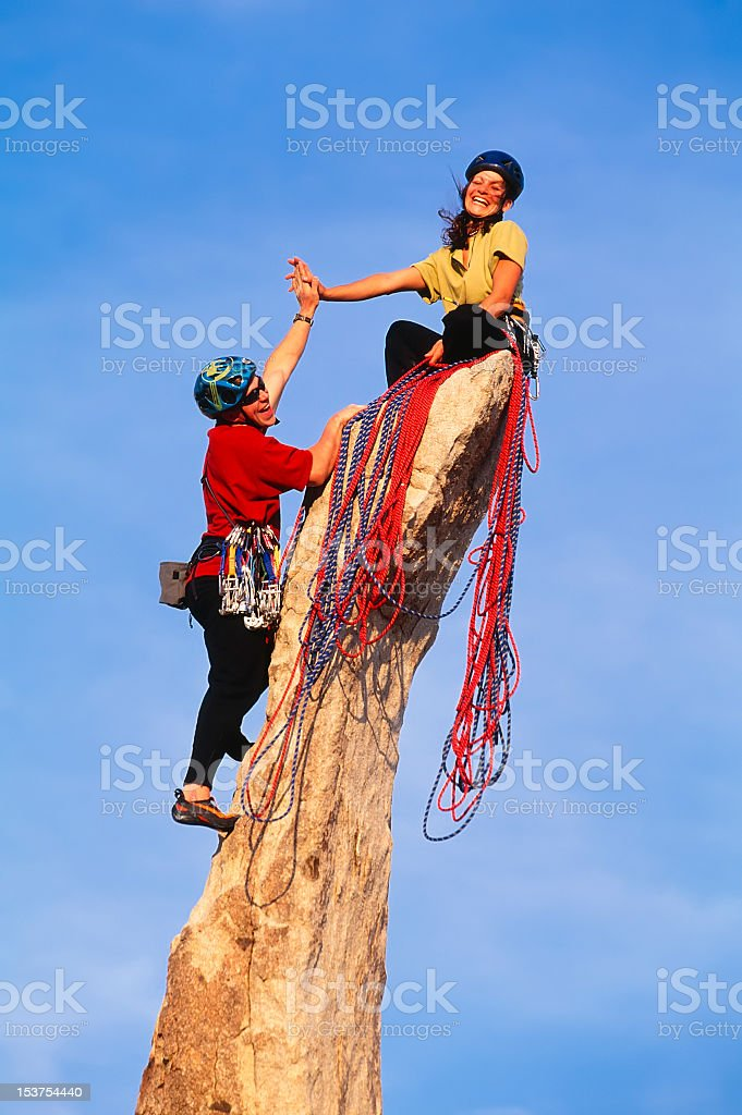 Rock climbing team reaching the summit. royalty-free stock photo