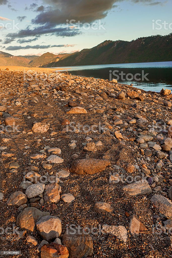 Rock covered beach. stock photo