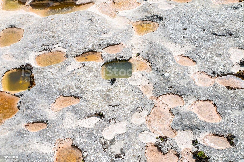 Rock erosion from waterhole marmites de geants scenic in France stock photo