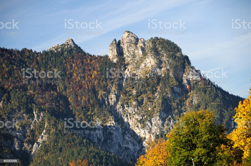 Rock formation alpine sleeping witch mountain range autumn stock photo