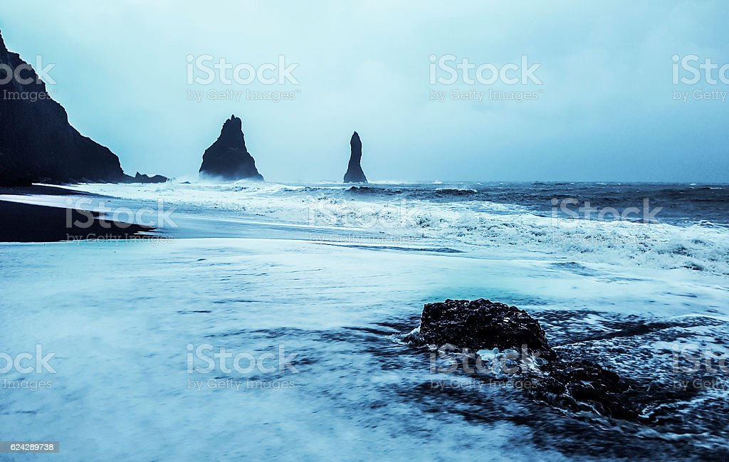 Rock formation on black volcanic beach at Cape Dyrholaey stock photo