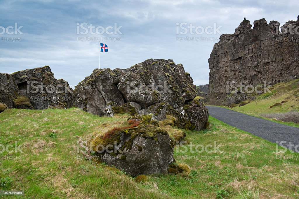 Rock formations and Icelandic flag stock photo