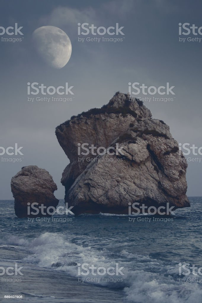 Rock formations on the beach at the 'u2018blue hour'u2019, Petra Tou Romiou, Aphrodite's Birthplace, Cyprus stock photo